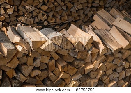 Hand chopped wooden logs put in particular order on a pile