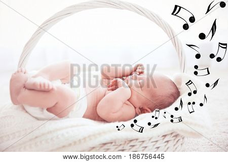 Cute baby sleeping in basket. Lullaby songs and music concept
