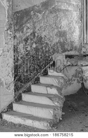 Stairs to No Where-black and white shot of stairs leading to nowhere, in an abandoned building