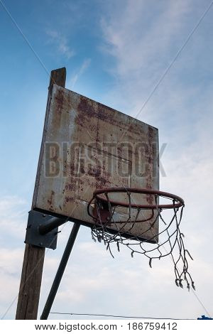 Old ruined basketball hoop in poor neighborhood