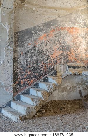 Concrete Stairs-dilapidated stairway leading to nowhere, with a colorful wall of chipping paint