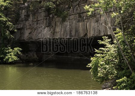 Flooded entrance into a secluded cave mouth