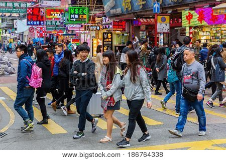 Hong Kong Hong Kong - March 11 2017: street scene in Kowloon Hong Kong with unidentified people. HK is one of worlds most significant financial centres and the 4th most densely populated state
