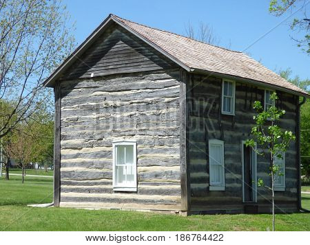 An Historic log house in a small town in Kansas.