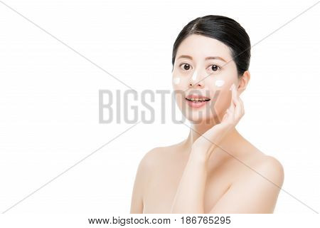 Asian Woman With Cosmetic Cream Lotion