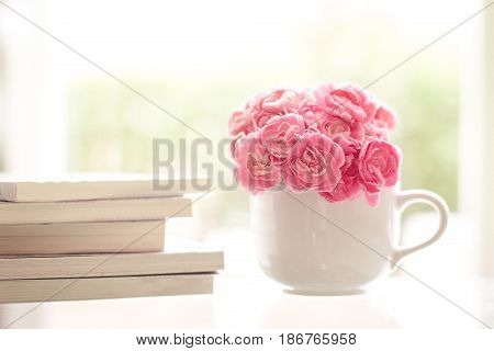 the fresh pink carnation flower with books background