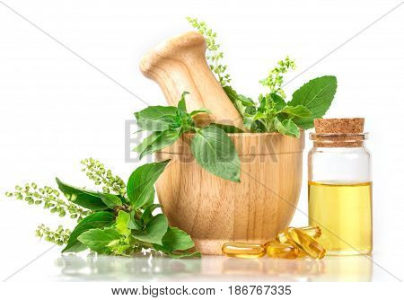 Sweet basil and hot basil in wooden mortar with essential oil and supplement alternative herbal medicine concept