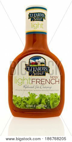Winneconne WI - 15 May 2017: A bottle TJ Farms light French salad dressing on an isolated background.