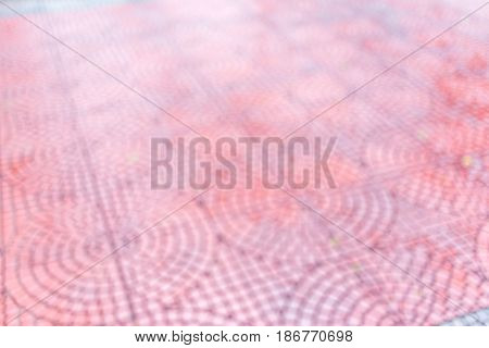 Abstract blurred photo of red brown pattern brick tile floor background.