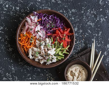 Asian style vegetables and poached chicken slaw. Healthy diet food concept. On a dark background top view