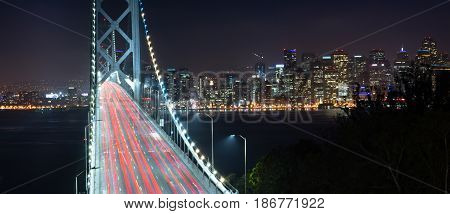 Car lights create streaks in this long exposure of the Bay Bridge