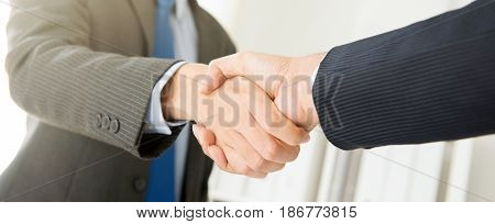 Businessmen making handshake panoramic banner - greeting dealing merger and acquisition concepts