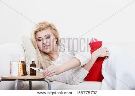Woman Being Sick Having Flu Lying On Sofa