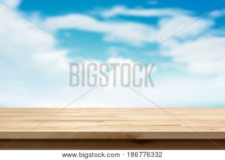 Wood table top on blur summer blue sky and cloud background - can be used for display or montage your products