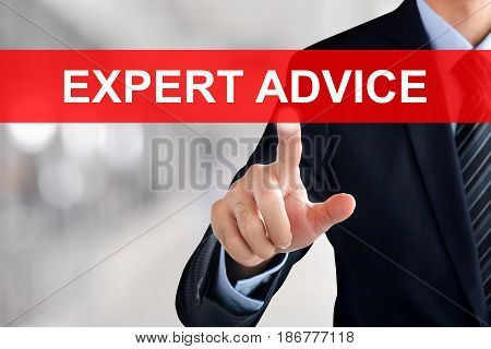 Businessman hand touching EXPERT ADVICE sign on virtual screen