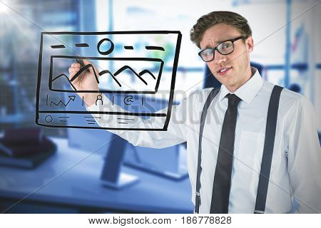 Geeky businessman writing with marker against blurry picture of computer on desk