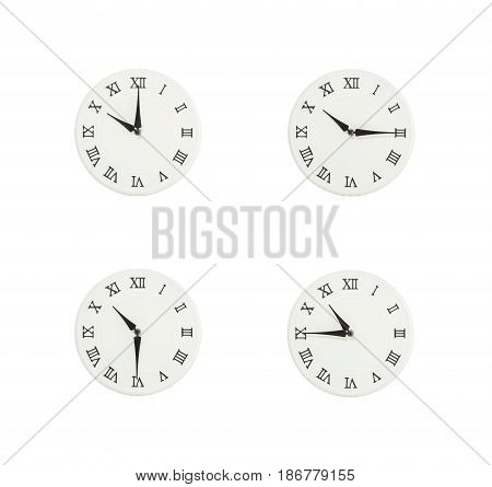 Closeup group of white clock with shadow for decorate show the time in 10 10:15 10:30 10:45 a.m. isolated on white background beautiful 4 wall clock picture in different time