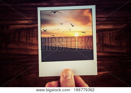 Polaroid Postcard Of Beautiful Sunset Over Ocean Coastline With Bird Silhouettes And Clouds. Travel