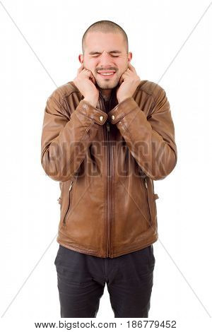 portrait of handsome young man covering his ears, isolated white background