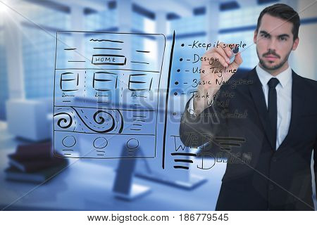 Serious businessman writing with marker against computer generated image of workplace