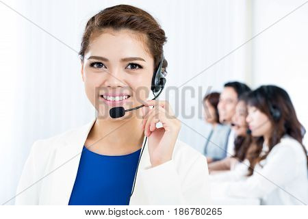 Smiling woman with headphone - telemarketer operator call center and customer service concepts