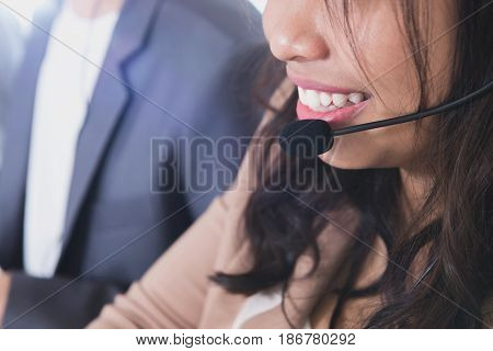 Smiling woman with microphone headset - telemarketer operator call center and customer service concepts