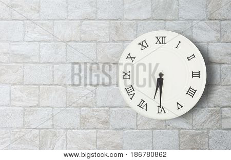 Closeup white clock for decorate show half past six or 6:30 a.m. on old brick wall textured background with copy space in interior concept