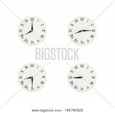 Closeup group of white clock with shadow for decorate show the time in 8 8:15 8:30 8:45 a.m. isolated on white background beautiful 4 wall clock picture in different time