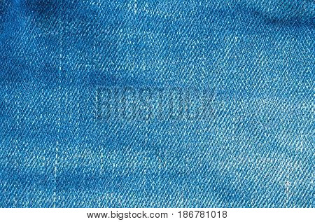 Closeup surface of old blue jean trousers fabric textured background