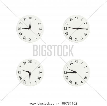 Closeup group of white clock with shadow for decorate show the time in 9 9:15 9:30 9:45 a.m. isolated on white background beautiful 4 wall clock picture in different time