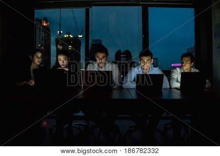 Group of business people working overtime in nighttime.