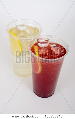 Refreshing and Cool Frozen Red and white Fruit Slush Drink with ice and lemon on isolate