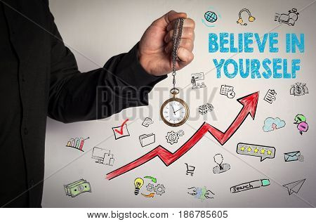 Believe In Yourself concept. Red Arrow and Icons Around. Man holding chain clock on white background.