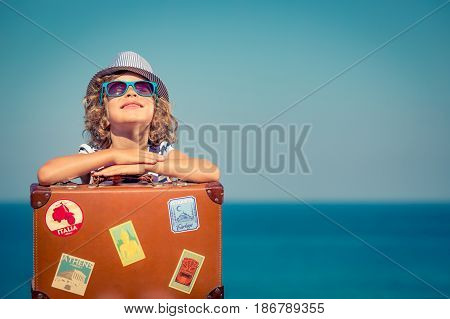 Child With Vintage Suitcase On Summer Vacation