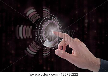 Cropped hand of businessman touching digital screen against digitally generated black and blue matrix