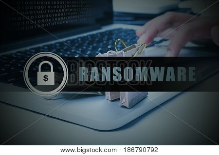 Binary code on laptop screen with finger clicking mouse pad trying to retrieve folder by paying ransom to hacker. Security technology concept.