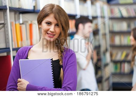 Portrait of a woman holding a notebook
