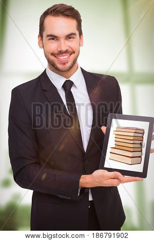 Smiling businessman showing his tablet pc against adhesive notes on window