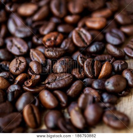 Coffee Beans Caffeine Roasted Brown Espresso  close up. Fried Coffee Beans Texture macro