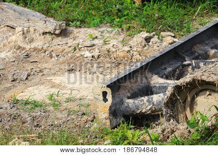 bucket small excavator orange crawler bulldozer in working