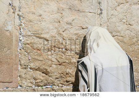 A Men is Praying At The Wailing Wall (western wall) , Jerusalem, Israel
