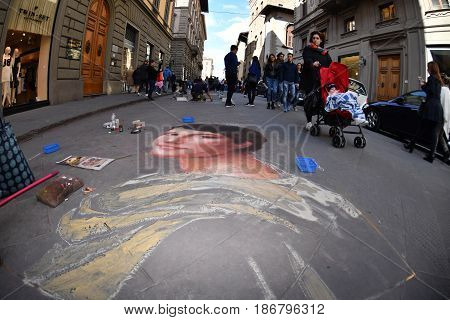 Florence, Italy - March 27 2017 - Pavement Artist Painting On The Streets