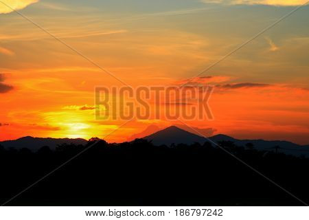 sunset beautiful and silhouette mountain tree woodland colorful landscape in sky twilight time
