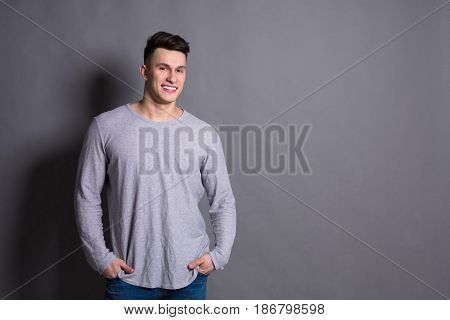 Young handsome man studio portrait. Boy style, trendy hipster in casual look with cool hairstyle, copy space