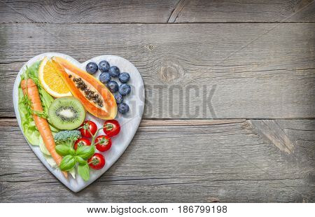 Healthy lifestyle with fresh fruits and vegetables on heart concept