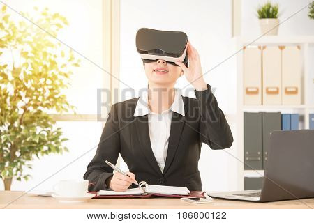 Joyful Businesswoman Holding Vr Goggles