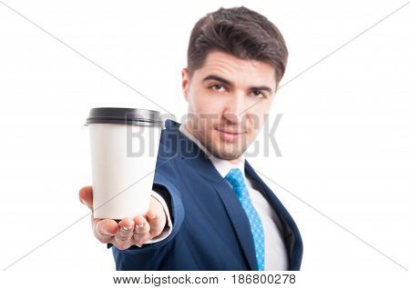 Portrait Of Young Salesman Holding Takeaway Coffee Cup