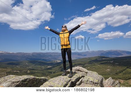 Happy Woman Outstretched Hands On Top Of Mountai