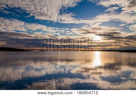 Reflection of the sunset sky in a large lake. Finland poster