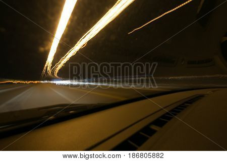 Street Lights In Speeding Car In Night Time, Light Motion With Slow Speed Shutter View From Inside F